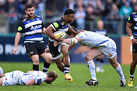 Kyle Eastmond of Bath Rugby takes on the Exeter Chiefs defence. Aviva Premiership match, between Bath Rugby and Exeter Chiefs on October 17, 2015 at the Recreation Ground in Bath, England. Photo by: Patrick Khachfe / Onside Images