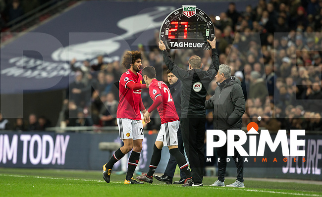 Marouane Fellaini of Man Utd comes off in place of Ander Herrera of Man Utd after coming on a short while earlier in the match during the Premier League match between Tottenham Hotspur and Manchester United at Wembley Stadium, London, England on 31 January 2018. Photo by Andy Rowland.