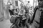 Shatila, UNRWA camp. A father drives his girls to school.<br />  <br /> Chatila, UNRWA camp. Un p&egrave;re emm&egrave;ne ses filles &agrave; l'&eacute;cole.