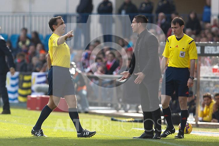 Atletico de Madrid´s coach Diego Pablo Simeone argues with the referee during 2014-15 La Liga match between Atletico de Madrid and Deportivo de la Coruña at Vicente Calderon stadium in Madrid, Spain. November 30, 2014. (ALTERPHOTOS/Victor Blanco)