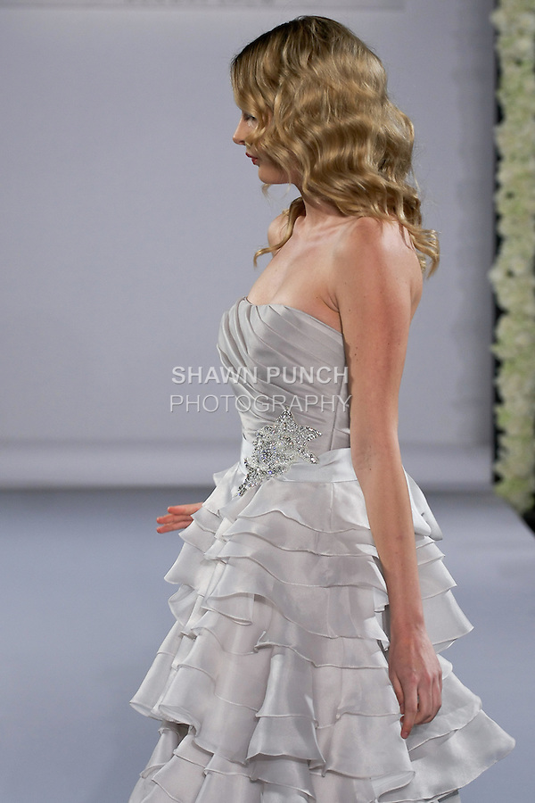 Model walks runway in a Jewel wedding dress from the Maggie Sottero Spring 2013 Bridal collection, for the Couture Runway Show, during New York Bridal Fashion Week at The Hilton Hotel, October 13, 2012.