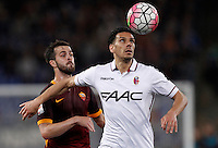 Calcio, Serie A: Roma vs Bologna. Roma, stadio Olimpico, 11 aprile 2016.<br /> Roma&rsquo;s Miralem Pjanic, left, and Bologna&rsquo;s Sergio Floccari eye the ball during the Italian Serie A football match between Roma and Bologna at Rome's Olympic stadium, 11 April 2016.<br /> UPDATE IMAGES PRESS/Isabella Bonotto