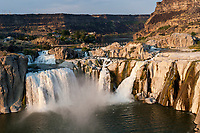 """The Snake River flows over Shoshone Falls in Idaho five miles east of Twin Falls. Shoshone Falls is often referred to as the """"Niagara of the West"""" due to its height of 212 feet, which is 36 feet higher than Niagara Falls and its 900 foot wide rim. Summer irragation and dams upstream limit the waters flow in the summertime. Photographed 08/06"""