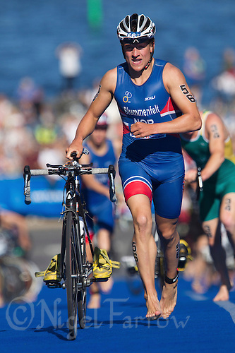 25 AUG 2013 - STOCKHOLM, SWE - Kristian  Blummenfelt (NOR) of Norway leaves transition for the start of the bike during the men's ITU 2013 World Triathlon Series round in Gamla Stan, Stockholm, Sweden (PHOTO COPYRIGHT © 2013 NIGEL FARROW, ALL RIGHTS RESERVED)