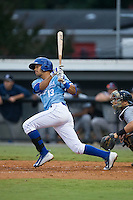 Angelo Castellano (13) of the Burlington Royals follows through on his swing against the Pulaski Yankees at Burlington Athletic Park on August 6, 2015 in Burlington, North Carolina.  The Royals defeated the Yankees 1-0. (Brian Westerholt/Four Seam Images)