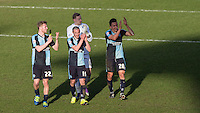 Jason McCarthy of Wycombe Wanderers, Goalkeeper Ryan Allsop (Loanee from Bournemouth) of Wycombe Wanderers, Michael Harriman of Wycombe Wanderers & Luke O'Nien of Wycombe Wanderers on the final whistle during the Sky Bet League 2 match between Wycombe Wanderers and Mansfield Town at Adams Park, High Wycombe, England on 25 March 2016. Photo by Andy Rowland.