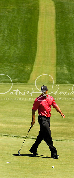 Tiger Woods walks around the green looking at a putt during the 2007 Wachovia Championships at Quail Hollow Country Club in Charlotte, NC.