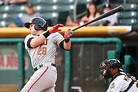 Adam Duvall (29) of the Fresno Grizzlies  at bat against the Salt Lake Bees at Smith's Ballpark on April 9, 2014 in Salt Lake City, Utah.  (Stephen Smith/Four Seam Images)