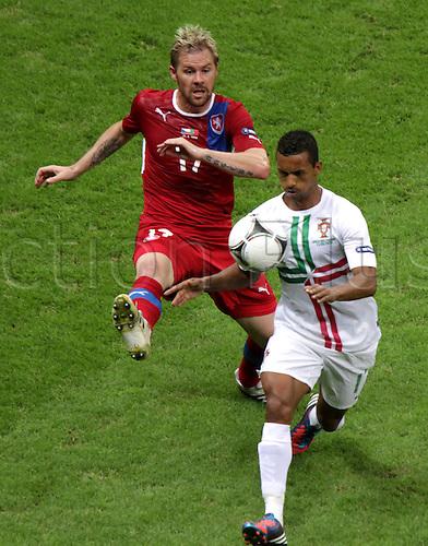 21.06.2012. Warsaw, Poland. , EURO 2012, FOOTBALL EUROPEAN CHAMPIONSHIP, Quarter-finals, Czech Republic versus Portugal.  NANI (POR) , TOMAS HUBSCHMAN (CZE)