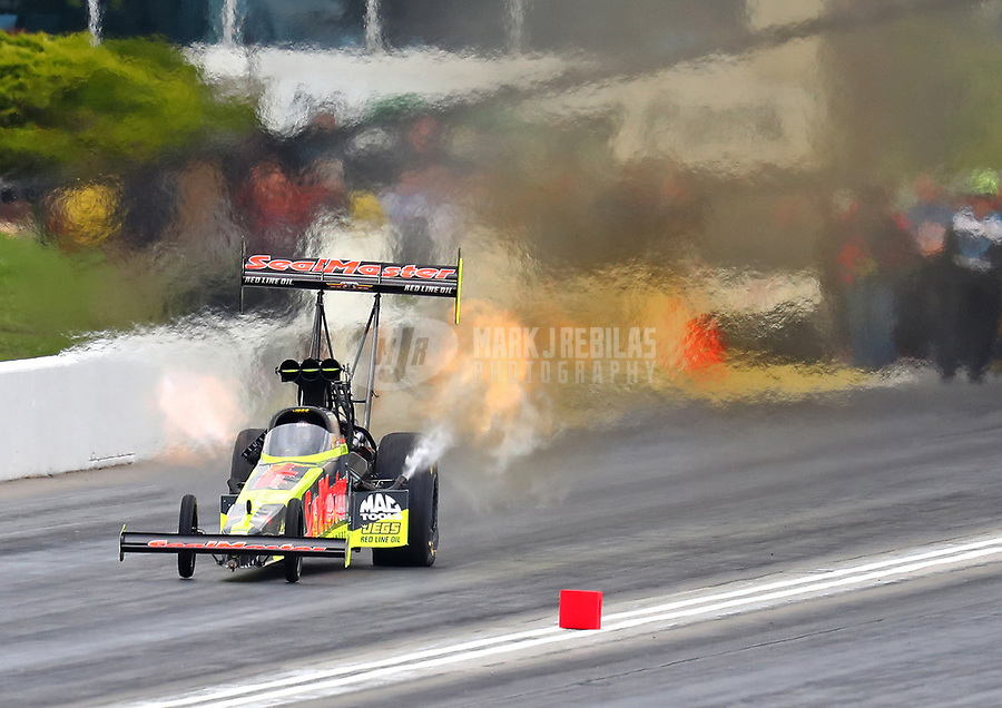 May 20, 2017; Topeka, KS, USA; NHRA top fuel driver Troy Coughlin Jr during qualifying for the Heartland Nationals at Heartland Park Topeka. Mandatory Credit: Mark J. Rebilas-USA TODAY Sports