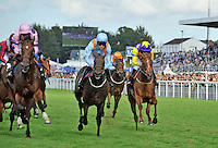 03.08.2013 Goodwood, England.  The race course in action during the 5.00pm Fairmont Nursery Stakes (Handicap)  during day five of the  Glorious Goodwood Festival. Winner Shot in the Sun ridden by Samantha Bell (centre blue silk)
