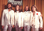 Bee Gees 1977  Barry Gibb, Robin Gibb, Maurice Gibb and Andy Gibb at Billboard Music Awards.