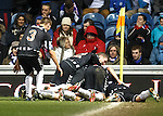 Elgin's players celebrate at the corner flag as they take a point from Ibrox