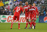 Fire players celebrate opeing goal...Kansas City Wizards played to a 2-2 tie with Chicago Fire at Community America Ballpark, Kansas City, Kansas.
