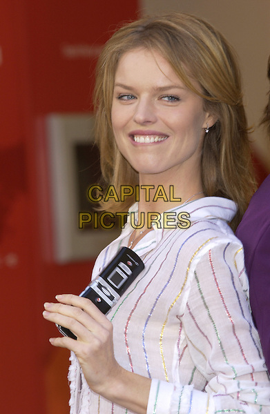 "EVA HERZIGOVA.launch  of ""Vodaphone live! with 3G"".high speedcamera phone.November 10th, 2004.Ref: PL.headshot, portrait, mobile phone, striped shirt, bitig bottom lip.www.capitalpictures.com.sales@capitalpictures.com.©Capital Pictures."
