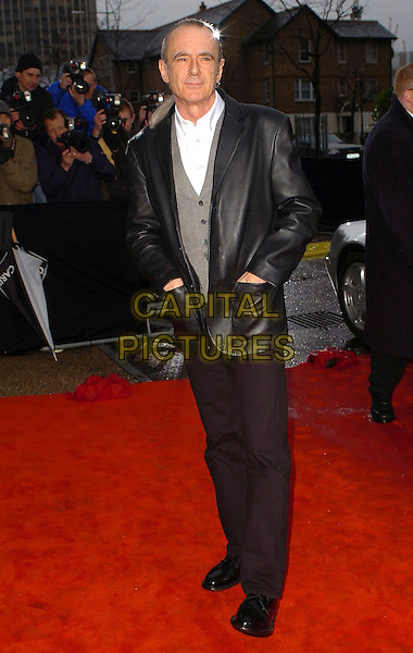 "RICK PARFITT .Arrivals for ""An Audience With Coronation St."" recording at LWT Studios, London, UK..Ref: CAN.street full length black leather jacket trousers hands in pockets.www.capitalpictures.com.sales@capitalpictures.com.©Capital Pictures"