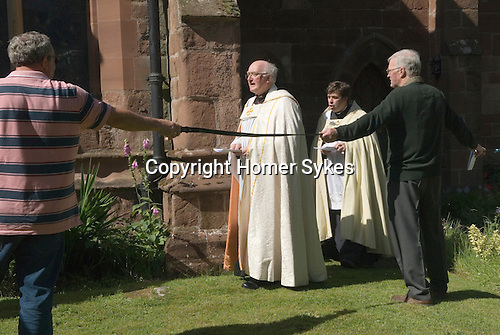 Church Clipping Ceremony St Peter.<br /> The Revd Prebendary Edward Ward,  and Father Mark Chadwick Rector of St Chads Shrewsbury.<br /> <br /> The congregation hold hands, in a circle around the whole of the church, if they can, they did just in 2015, with the use of belts and ropes to complete the unbroken circle.  <br /> The Revd Prebendary Edward Ward and father Mark Chadwick.<br /> <br /> The word &quot;clipping&quot; is Anglo-Saxon in origin, and is derived from the word &quot;clyp-pan&quot;, meaning &quot;embrace&quot; or &quot;clasp&quot; and thus is an expression of devotion.