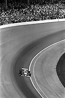 INDIANAPOLIS, IN - MAY 24: Bobby Unser drives his Penske PC9B/Cosworth through Turn 1 en route to winning the Indianapolis 500 USAC/CART Indy Car race at the Indianapolis Motor Speedway in Indianapolis, Indiana, on May 24, 1981.