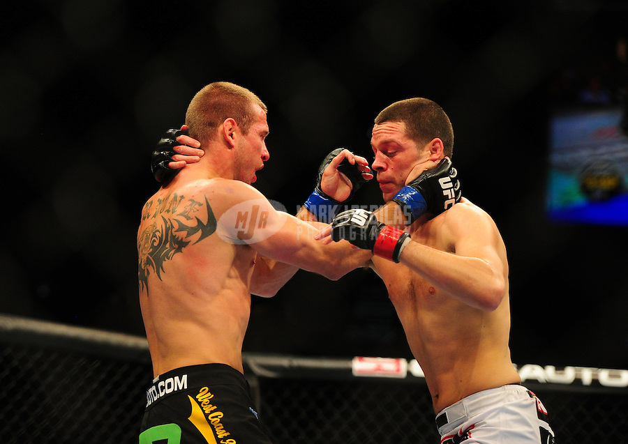 Dec 30, 2011; Las Vegas, NV, USA; UFC fighter Nate Diaz (right) against Donald Cerrone during a lightweight bout at UFC 141 at the MGM Grand Garden event center. Mandatory Credit: Mark J. Rebilas-