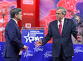 Former Governor Jeb Bush (Republican of Florida), right, is interviewed by Sean Hannity of Fox News, left, as he speaks at the Conservative Political Action Conference (CPAC) at the Gaylord National at National Harbor, Maryland on Friday, February 27, 2015.<br /> Credit: Ron Sachs / CNP