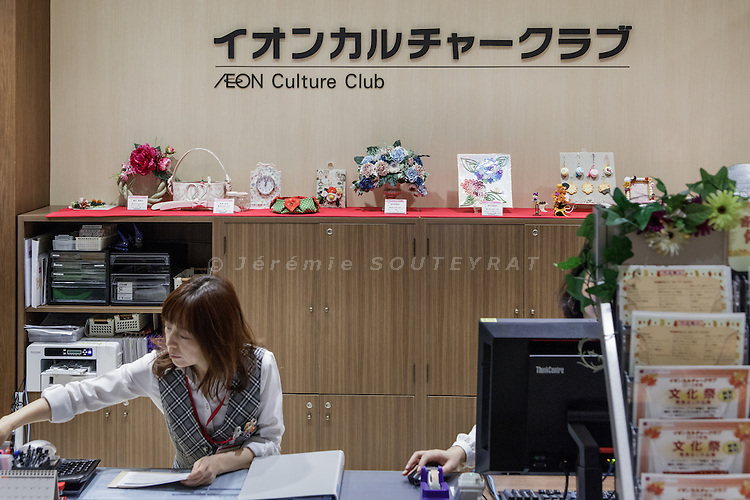Tokyo, October 15 2015 - Front desk of the &quot;Culture Club&quot; at Aeon Kasai.<br /> Aeon Kasai is a shopping mall offering classes for older people including knitting, computer classes and music lessons. The event space features singers popular in the 1960s and lectures on medical treatments. This programm is called Grand Generation.