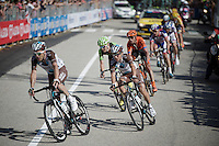 team leader and overall contender Domenico Pozzovivo (ITA/Ag2r-La Mondiale) is escorted back to the peleton after having crashed in the local laps in Genova<br /> <br /> 2015 Giro<br /> stage 2: Albenga - Genova (177km)