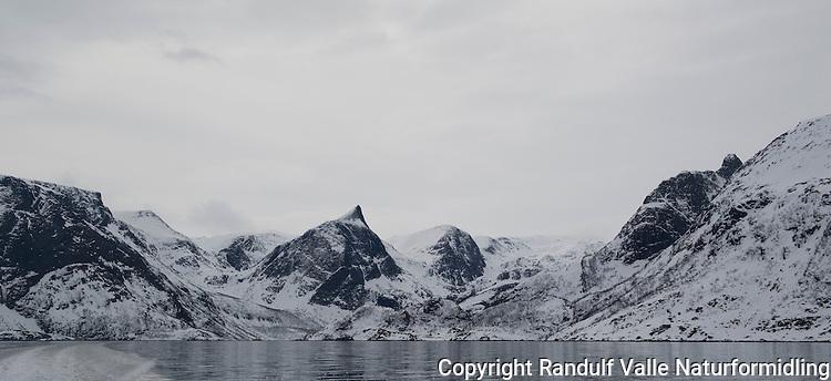 Flaskefjorden på Seiland sett fra sjøen en grå vårdag med uvære i anmarsj. ---- Flaskefjorden on Seiland on a spring day.