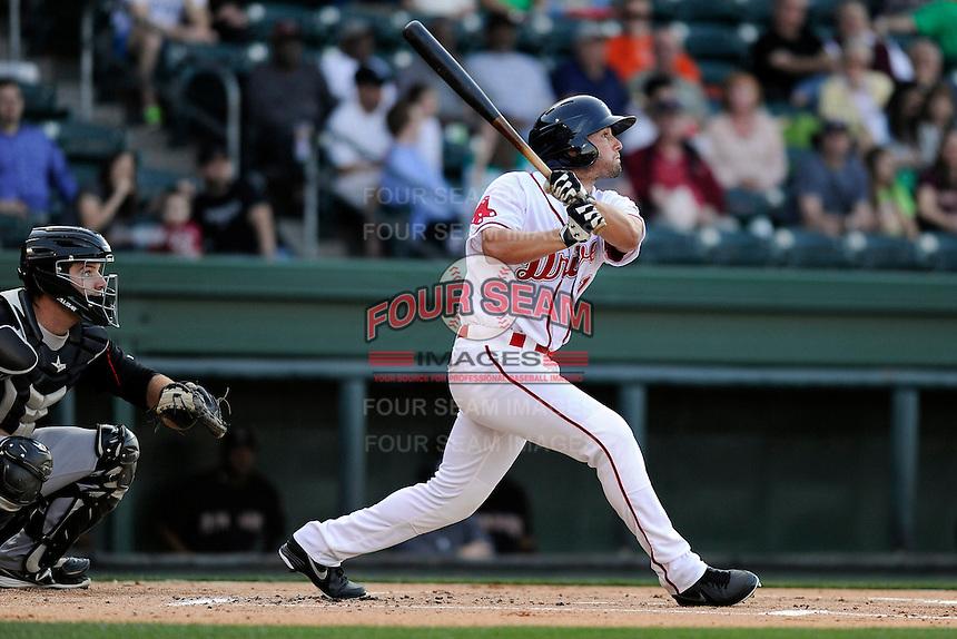 Outfielder Bo Greenwell (31) of the Greenville Drive bats in a game against the Kannapolis Intimidators on Friday, April 11, 2014, at Fluor Field at the West End in Greenville, South Carolina. The Kannapolis catcher is Jeremy Dowdy. Greenville won, 13-2. (Tom Priddy/Four Seam Images)