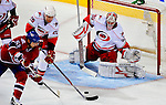 31 March 2010: Carolina Hurricanes' goaltender Cam Ward makes a second period save against the Montreal Canadiens at the Bell Centre in Montreal, Quebec, Canada. The Hurricanes defeated the Canadiens 2-1 in their last meeting of the regular season. Mandatory Credit: Ed Wolfstein Photo