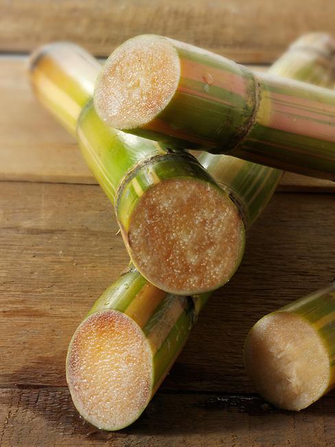 Sticks of raw sugar cane cut to show the inside