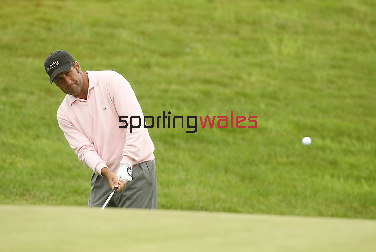 Jose Maria Olazabal chips onto the 4th green during the 2nd round of the ISPS Handa Wales Open 2012...01.06.12.©Steve Pope