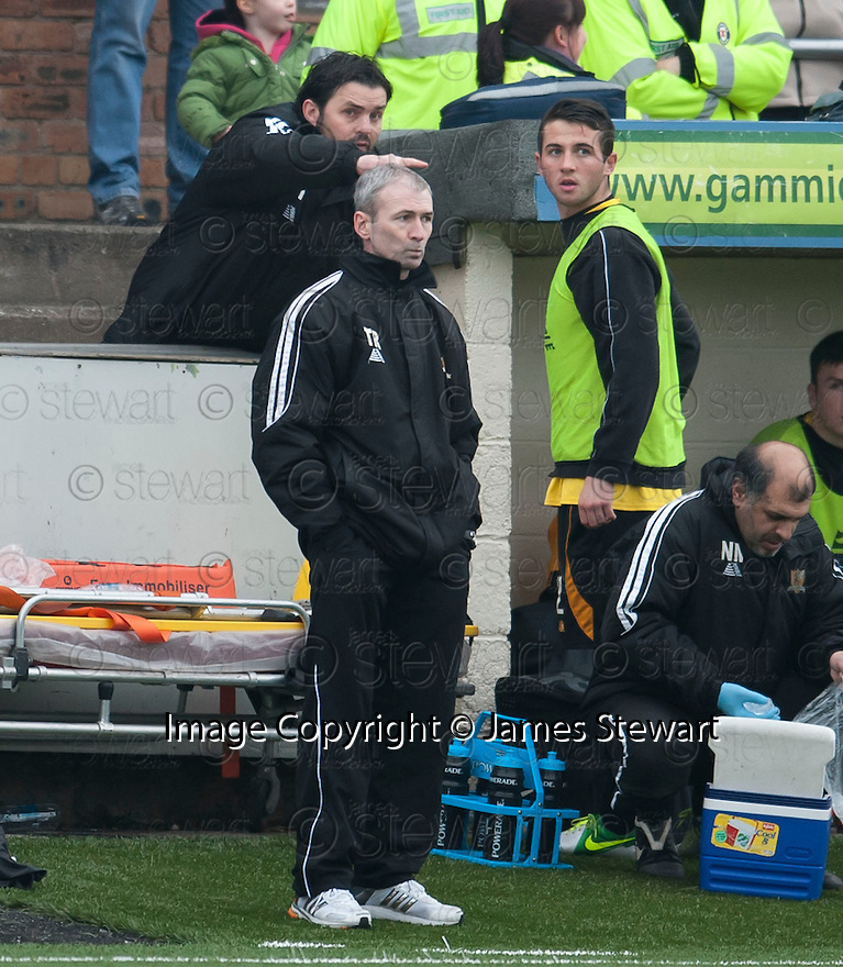 Alloa Manager Paul Hartley gets instructions to sub Alloa's Gavin Stokes from his position in the enclosure, behind the dug out, before he comes on.