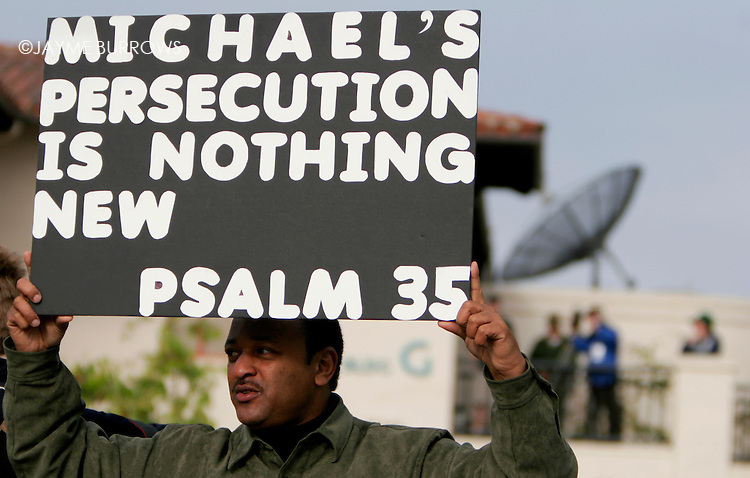 Najee Ali of Los Angeles holds up a sign in from of the Santa Barbara County courthouse outside of the Michael Jackson child molestation trial in Santa Maria, Calif on Thursday, March 17, 2005.  ..
