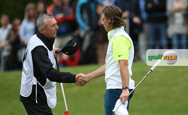 Tommy Fleetwood (ENG) shakes the hand of caddie Phil Morbey after a stunning 65 during Round Three of the 2015 BMW PGA Championship over the West Course at Wentworth, Virginia Water, London. 23/05/2015. Picture David Lloyd | www.golffile.ie.