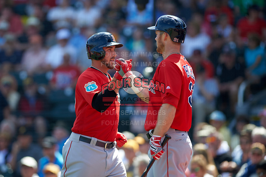 Boston Red Sox Travis Shaw (left) fist bumps Brennan Boesch after scoring a run during a Spring Training game against the Pittsburgh Pirates on March 9, 2016 at McKechnie Field in Bradenton, Florida.  Boston defeated Pittsburgh 6-2.  (Mike Janes/Four Seam Images)