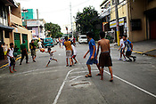 Filipino youth play basketball at the Benitez St. Quirino Avenue in Malate, Manila in Philippines. Photo: Sanjit Das