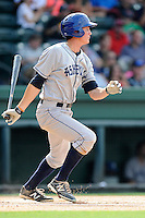 Right fielder Jordan Patterson (10) of the Asheville Tourists bats in a game against the Greenville Drive on Sunday, July 20, 2014, at Fluor Field at the West End in Greenville, South Carolina. Asheville won game two of a doubleheader, 3-2. (Tom Priddy/Four Seam Images)