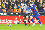 Lionel Andres Messi of FC Barcelona competes for the ball with Martin Montoya Torralbo of Valencia CF during the La Liga 2017-18 match between Valencia CF and FC Barcelona at Estadio de Mestalla on November 26 2017 in Valencia, Spain. Photo by Maria Jose Segovia Carmona / Power Sport Images