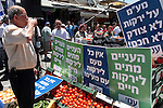 Fruit and vegetable merchants in the Machane Yehuda Market in Jerusalem protest against the governmental decree to raise V.A.T taxes, Monday, June 29, 2009. This evening, Israel's Knesset (Parliament) is to approve a temporary order raising the rate of value added tax (V.A.T) by 1%, from 15.5% to 16.5%. The change will come into effect on Wednesday, July 1. All coalition MKs are expected to vote in favor. Photo By: Tess Scheflan / JINI