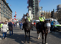 Mounted police presence at BREXIT Protests on the day the UK was due to leave Europe in London on 29 March 2019. Photo by Alan  Stanford.