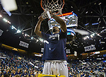 Nevada's Jordan Caroline cuts down the net after their win over Colorado State for the Mountain West Championship in a NCAA college basketball game in Reno, Nev., Sunday, Feb. 25, 2018. (AP Photo/Tom R. Smedes)