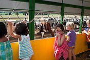 A group of children from the Chapel Hill-Carrboro YMCA summer camp visit Maple View Farms on Friday, July 2, 2010.