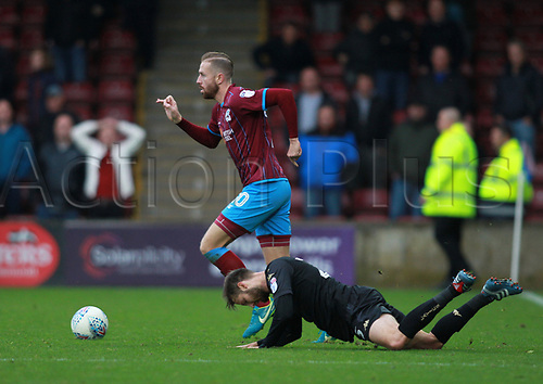 7th October 2017, Glanford Park, Scunthorpe, England; EFL League One football, Scunthorpe versus Wigan; Kevin van Veen of Scunthorpe United leaves Nick Powell of Wigan Athletic on the floor as he moves forward with the ball