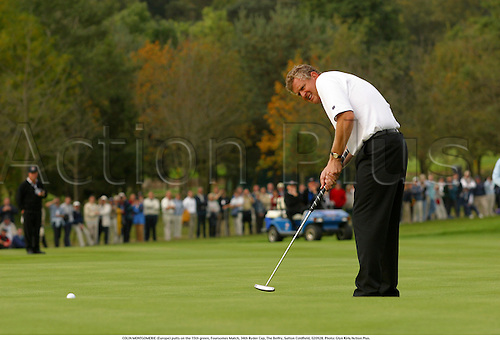 COLIN MONTGOMERIE (Europe) putts on the 15th green, Foursomes Match, 34th Ryder Cup, The Belfry, Sutton Coldfield, 020928. Photo: Glyn Kirk/Action Plus....2002.golf golfer player.putting putt