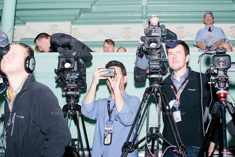 Members of the media stand with their cameras as real estate mogul and Republican presidential candidate Donald Trump speaks at a rally at Exeter Town Hall in Exeter, New Hampshire, on Thurs., Feb. 4, 2016.