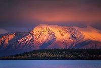 Naknek Lake and sunset light on snow covered Mt. Katolinat, Katmai National Park, Alaska.