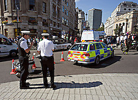 Metropolitan Police and City of London Police officers in Trafalgar Square London UK 13th September 2005. The police are there to ensure safety and public order. This image may only be used to portray the subject in a positive manner..©shoutpictures.com..john@shoutpictures.com