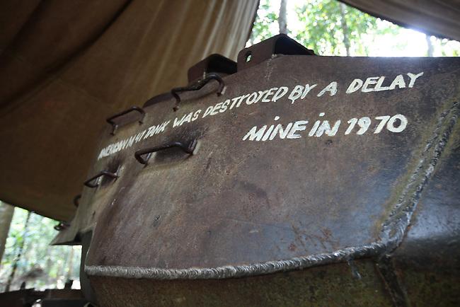 An inscription on a U.S. tank details its destruction at the Chu Chi tunnel complex in Cu Chi, Vietnam. Vietnam. July 2, 2011.