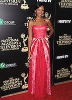 BEVERLY HILLS, CA - JUNE 22:  Mishael Morgan at the 41st Annual Daytime Emmy Awards at the Beverly Hilton Hotel on June 22, 2014 in Beverly Hills, California. SKPG/MPI/Starlitepics