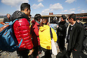 A guide talks to foreign visitors at the remains of Okawa Elementary School on March 11, 2016 in Ishinomaki, Miyagi Prefecture, Japan. Exactly 5 years earlier 74 out of the school's 108 students lost their lives as a result of the tsunami on March 11th, 2011. There are plans to rebuild the school but as yet this has not been fixed. The fate of the destroyed buildings is also expected to be decided soon with residents of the town divided as to whether they should be preserved as a memorial or removed. (Photo by Yusuke Nakanishi/AFLO)